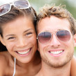 happy young beach couple closeup portrait — Stock Photo