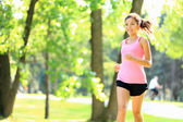 Runner - woman running in park — Stock Photo
