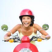 Excited woman on scooter happy — Stock Photo
