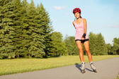 Roller skating girl in park — Stock Photo