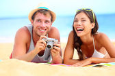 Young happy multicultural couple on beach — Stock Photo