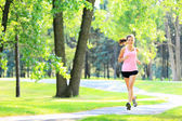 Jogging woman running in park — Stock Photo