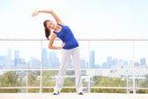 City workout woman stretching — Fotografia Stock