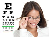 Optometrist or optician with eyewear glasses — Stock Photo