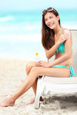 Suntan lotion - woman applying sunscreen — Stock Photo