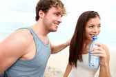 Young couple beach workout — Stock Photo