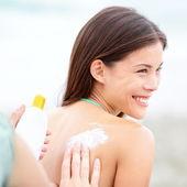 Sunscreen lotion on beach — Stock Photo
