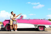 Vintage car - couple pointing — Stock Photo