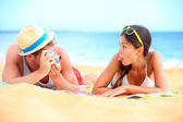 Young couple having fun on beach — Stock Photo