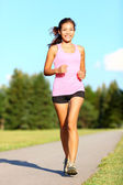 Power walking woman in park — Stock Photo