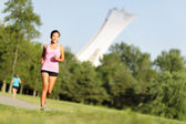 Running fitness in summer city park — Stock Photo