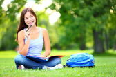 Student thinking looking in park — Stock Photo