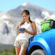 Car road trip woman eating in Yosemite Park — Stock Photo