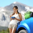 Stock Photo: Car road trip woman eating in Yosemite Park