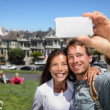 Happy young couple in San Francisco Alamo Square — Stock Photo #25234187