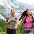 Happy couple of hikers hiking in Yosemite — Stock Photo #25234229