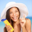 Sunscreen woman applying suntan lotion laughing — Stock Photo #25234297