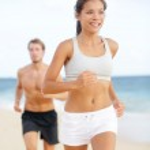 Running couple - woman fitness runner happy — Stock Photo