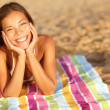 Stock Photo: Beautiful womsunbathing on beach
