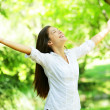 Young woman meditating with open arms - Stockfoto