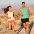 Running couple - runners jogging on trail run path — Stock Photo