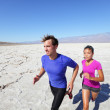 Trail running marathon athletes outdoors in desert — Stock Photo