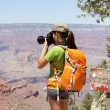 Stock Photo: Hiking photographer taking pictures, Grand Canyon