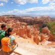 Hikers in Bryce Canyon resting enjoying view — Stock Photo #25234825