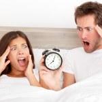 Oversleeping - horrified couple have overslept — Stock Photo