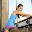 Stock Photo: Runner stretching and running, Brooklyn, New York