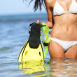 Travel beach fun concept - woman snorkeling fins - Stock Photo