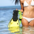 Travel beach fun concept - woman snorkeling fins — Stock Photo