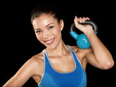 Fitness cross fit woman holding kettlebell — Stock Photo