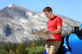 Driver man looking at map by car in Yosemite Park — Stock Photo