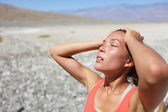 Desert woman thirsty dehydrated in Death Valley — Stok fotoğraf