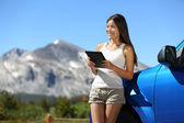 Traveler woman using tablet on Yosemite road trip — Stock Photo