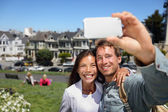 Happy young couple in San Francisco Alamo Square — Stock Photo