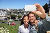 Happy young couple in San Francisco Alamo Square — Stock Photo