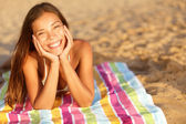 Beautiful woman sunbathing on the beach — Stock Photo