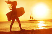 Summer woman body surfer beach fun at sunset — Stock Photo