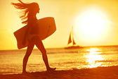 Summer woman body surfer beach fun at sunset — Stock Photo