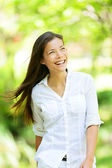 Joyful woman in a spring or summer park — Stock Photo