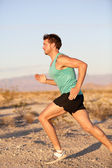 Runner sport man running and sprinting outside — Stock Photo