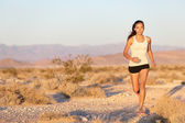 Woman runner running cross country trail run — 图库照片