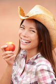 Peach eating cowgirl happy portrait — Stock Photo