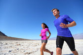 Running fitness sport runners in extreme run — Stock Photo