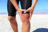 Injuries - sports running knee injury on man — ストック写真