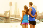 Fitness couple relaxing after running in New York — Stock Photo