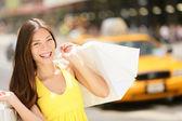 Happy shopper holding shopping bags, New York City — Stock Photo