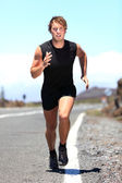 Man jogging on a country road — Stock Photo